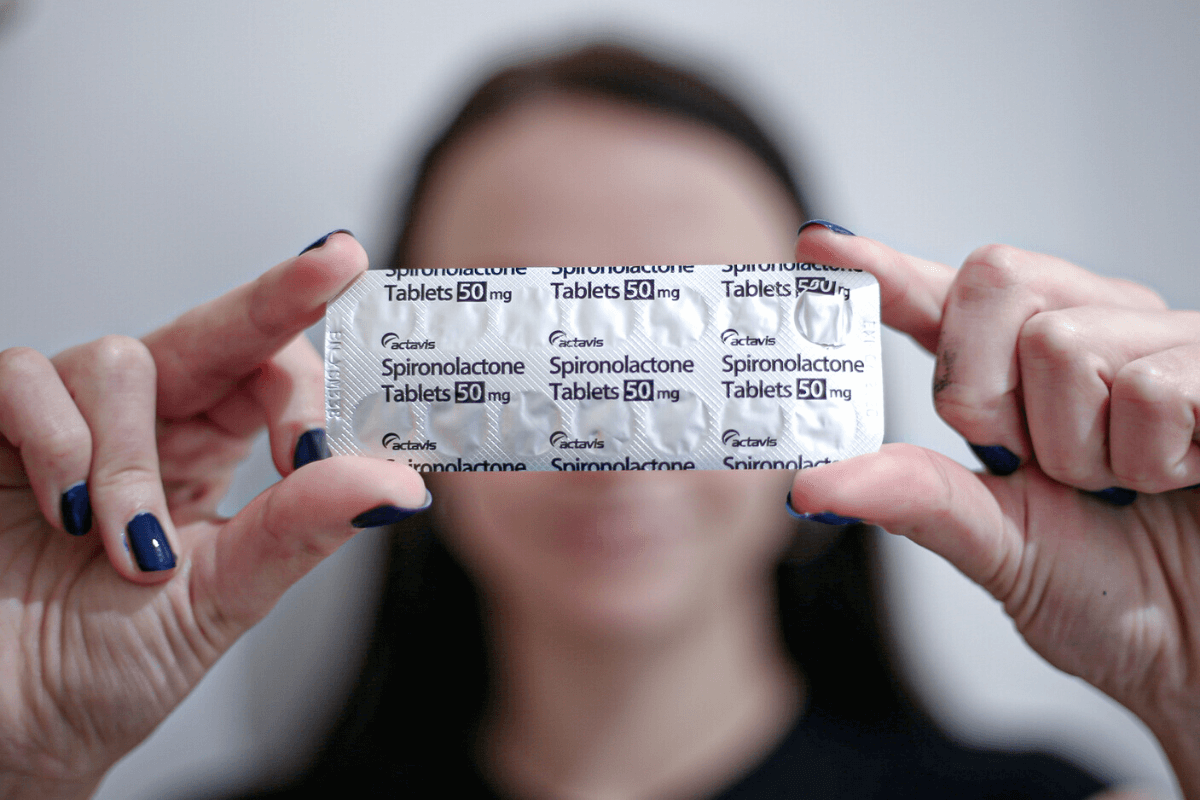 Girl holding spironolactone for acne 50mg